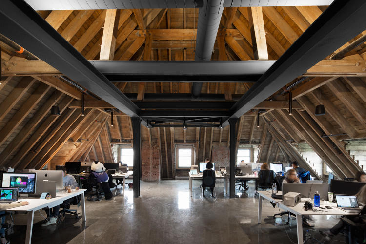 <p>Over 200 people will work in the office. In the upper floor, the timber roof beams are left bare. The juxtaposition of new and old &quot;gives the space a unique character and allowed us easily insert the other anecdotal design component—such as the pool, the cabanas, and the anamorphic design—without giving the impression that the space is over designed,&quot; Frappier says.</p>