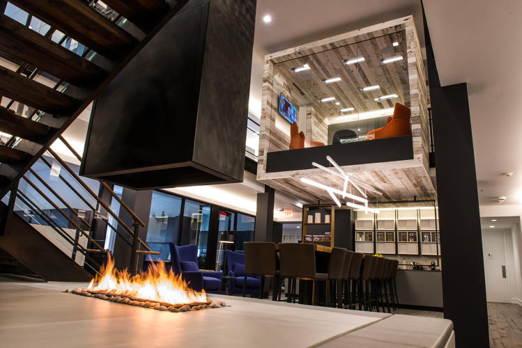 <p>Various stone, wood and even a fire element were brought into this office space for Atlas Holdings, designed by HLW International with furnishings solutions by Workwell Partners.</p>