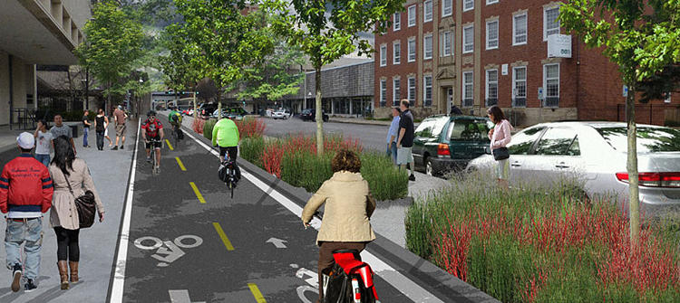 <p>Lincoln's new protected bike lane features rain-garden strips, dedicated bike signal &quot;phasing,&quot; and links between regional paths through the university district and downtown.</p>