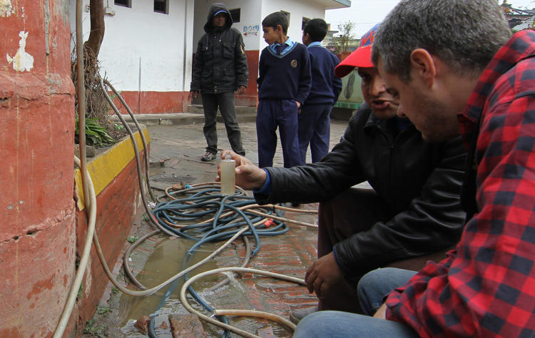 <p>Funded with a grant from Google.org, the sensor wraps around the water pipe, measuring the water level in a central chamber.</p>