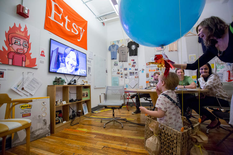 <p>Kids and coworkers mingle at one of Etsy's family-friendly, in-office events.</p>
