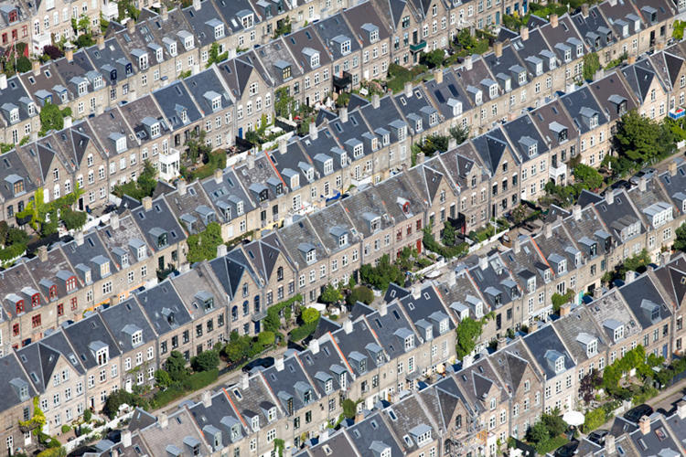 <p>In part, it's a function of sprawl. American suburbs have a hefty footprint largely because of long commutes and oversized houses. Photo: <a href=&quot;http://www.landslides.com/Upload/Europe-Energy/&quot; target=&quot;_blank&quot;>Alex MacLean</a></p>