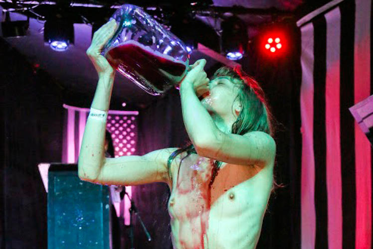 <p>A nude woman guzzles wine from a growler during Jex Blackmore's sermon at a satanic ritual following an Austin screening of &quot;The Witch.&quot;</p>