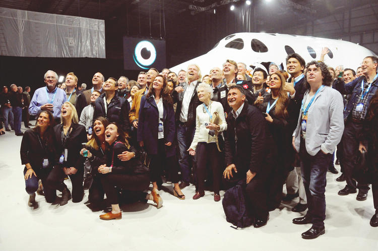 <p>Branson poses for a photo with a couple dozen of Virgin Galactic's paying passengers, the so-called &quot;future astronauts.&quot;</p>