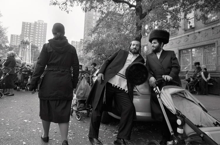 <p><em>Two Men at Carnival for Sukkah</em> on Taylor Street, Brooklyn, NY</p>
