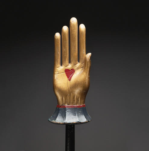 <p>Odd Fellows heart-in-hand staff, ca. 1890s, polychrome wood, 10 inches by 4 inches by 2 inches on 52-inch rod, Webb Collection</p>