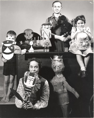 <p>Alexander Girard and his family posing with items from his folk art collection, 1952,</p>