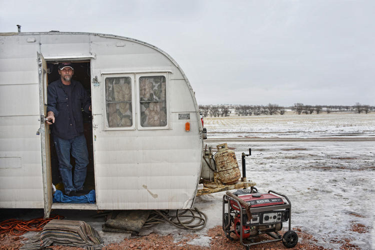 <p>Keith Day, Type 3 camp near Alexander, ND. Keith was making $1600/week for holding a sign that said Stop and Slow on the roads leading to the oil rigs.</p>