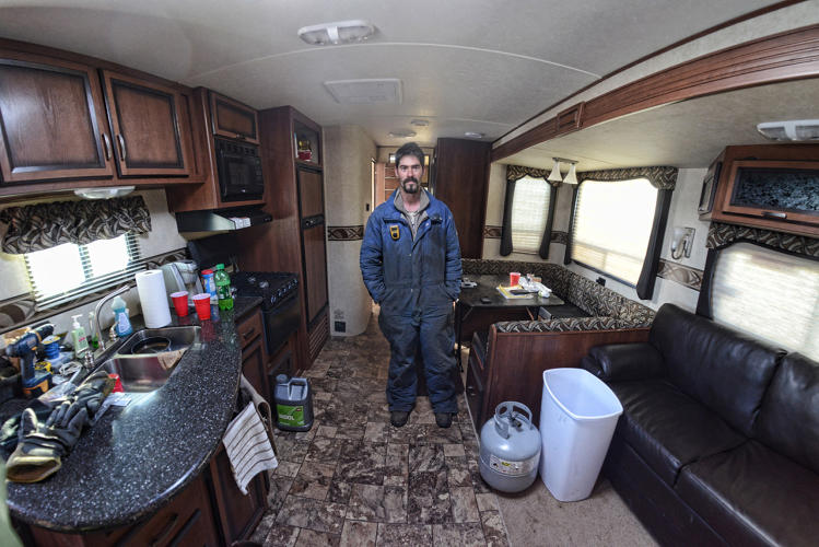 <p>Truck driver Clint Breeze. Type 2 camp near Tioga, ND.</p>