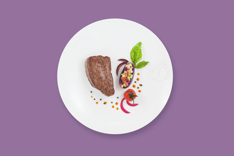 <p>Seared beef tenderloin on a tangy slice of eggplant and avocado, tomato juice—Air France</p>