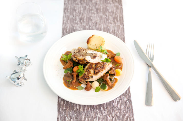 <p>Chicken with root vegetables—Virgin Atlantic</p>