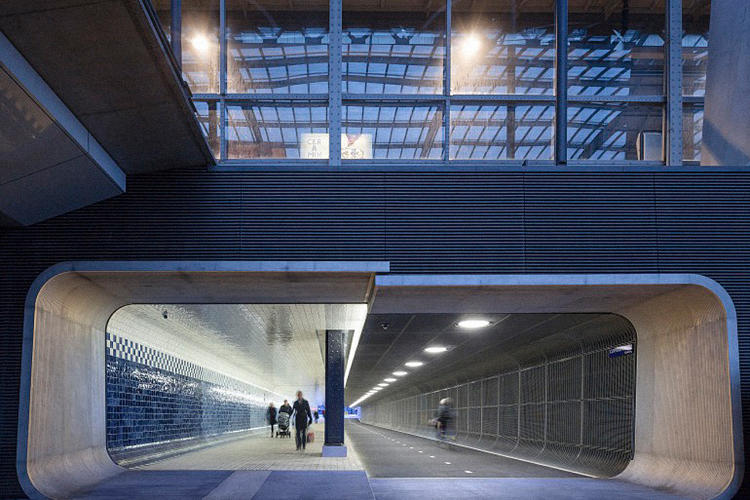 <p>The tunnel is divided into light and dark sides. The light side, for pedestrians, is lined with a huge tiled mural by artist Irma Bloom.</p>