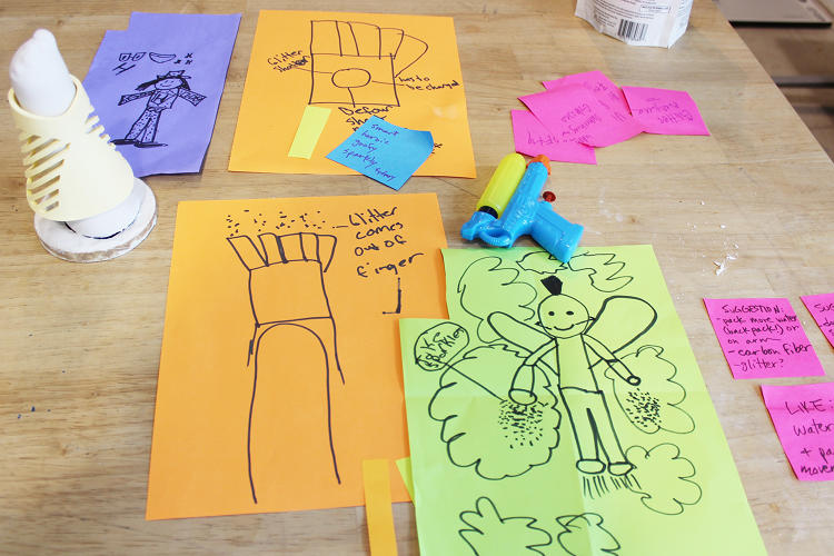 <p>Jordan's early sketches of her sparkle arm. The kids were encouraged to brainstorm and then narrow their ideas down to one.</p>
