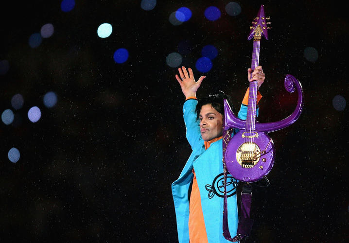<p>Prince in a slick turquoise and orange suit for the Super Bowl XLI, 2007.</p>