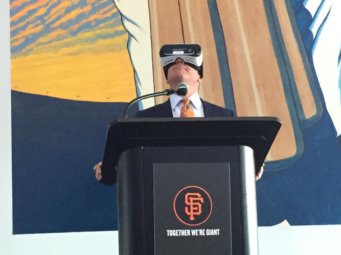 <p>Giants executive Mario Alioto demonstrates using a Gear VR at the team's media day.</p>
