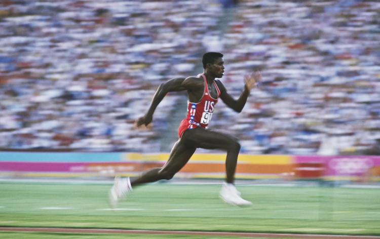 <p>Los Angeles 1984: American Carl Lewis accelerates down the runway of the long jump.</p>