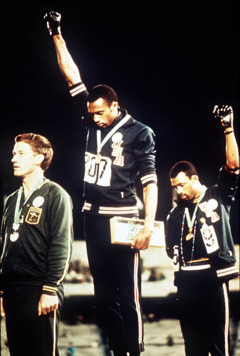 <p>Mexico City 1968: American gold and bronze medallists Tommie Smith (C) and John Carlos give the black power salute as an anti-racial protest.</p>
