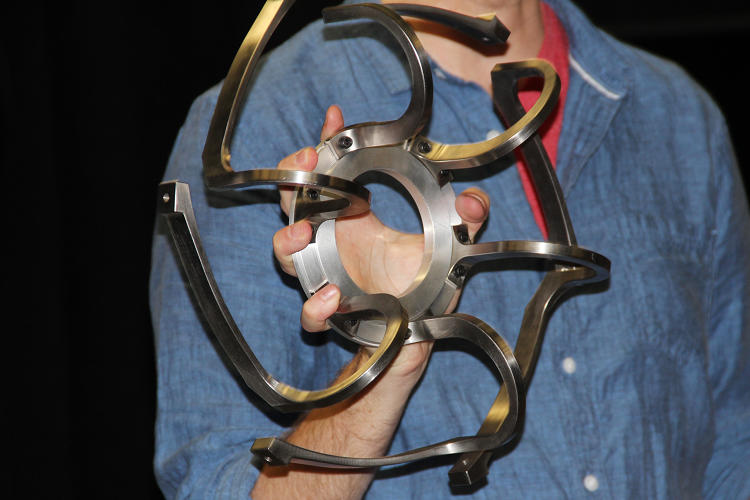 <p>Jeff Norris, JPL's mixed reality projects lead, holds a 3D printed Mars2020 wheel section.</p>