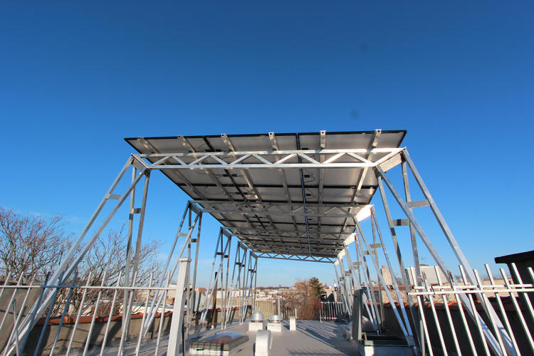 <p>A new canopy is a simple solution: By lifting solar panels ten feet in the air, it's possible to meet safety requirements and add solar.</p>