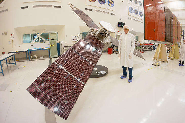 <p>Juno mission planner Stuart Stephens stands next to a quarter-scale model of the Juno spacecraft in the JPL clean room.</p>