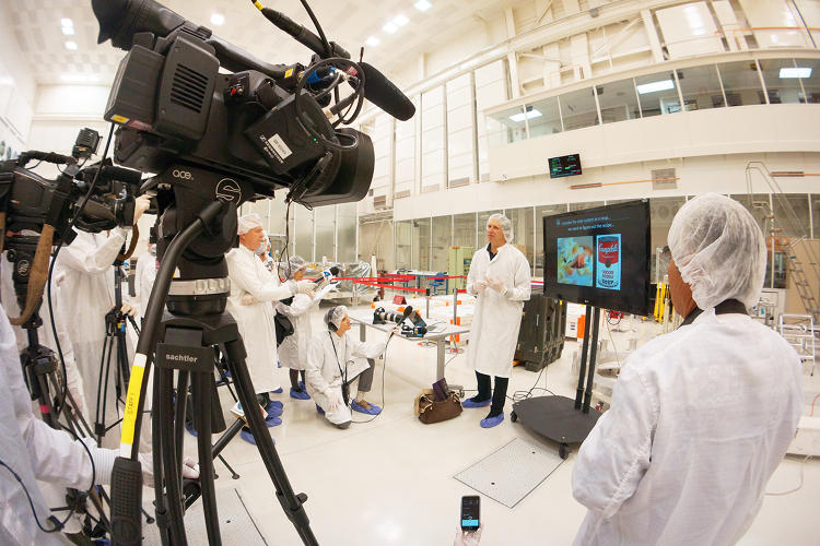 <p>Juno principal investigator Scott Bolton explains the Juno mission to press during a media day in the JPL clean room.</p>