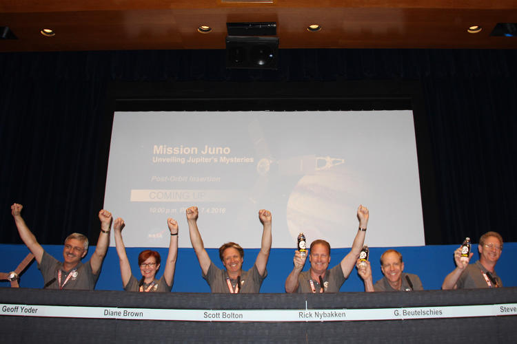 <p>Juno made it! Celebrations in the post-Jupiter Orbit Insertion briefing.</p>