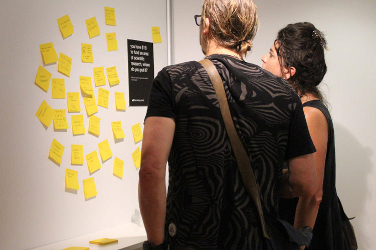 <p>Nt5: Another participatory wall that encouraged visitors to write on a post-it where they would put 1B dollars for scientific research.</p>