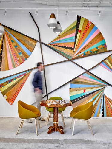 <p>Etsy turned the desks from its previous location into wall art.</p>