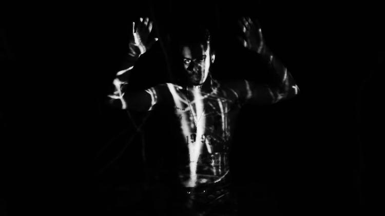 <p>Vic Mensa in the video for &quot;Wolves&quot;</p>