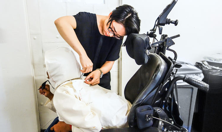 <p>Yuchen Zhang, the designer on team Justin, testing the jacket</p>