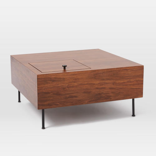 <p>The <a href=&quot;http://www.westelm.com/products/commune-low-wooden-side-table-large-h2268/?pkey=ccommune&amp;&amp;ccommune&quot; target=&quot;_blank&quot;>Commune and West Elm Low Wooden Side Table</a> (large)</p>