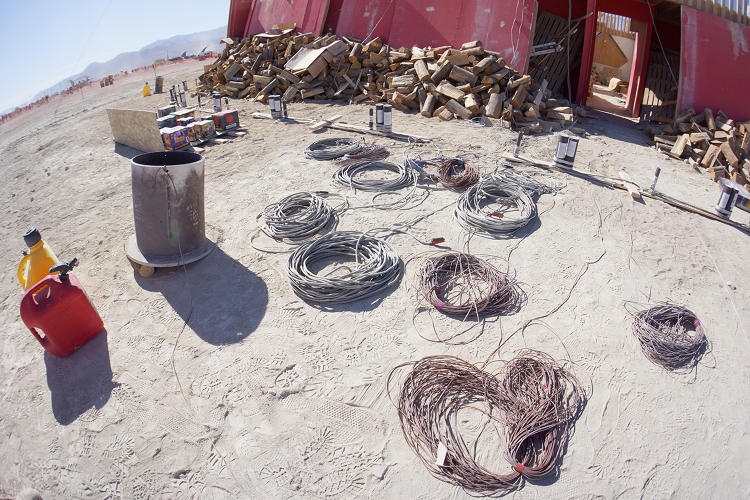 <p>The pyro crew runs cables from the explosive devices to the control board.</p>