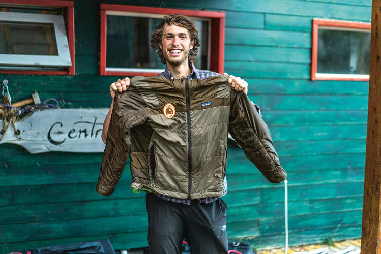 <p><strong>Martin Lopez Abad</strong> proudly shows off his rebuilt Worn Wear jacket in El Chaltén, Patagonia.</p>