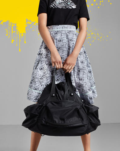 <p>This skirt is made from a tissue-thin polyester that's coated with waterproofing.</p>