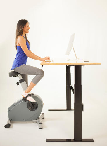 <p>A button raises and lowers the desk to a standing, cycling, or sitting height, and the bike rolls out of the way when it isn't needed.</p>