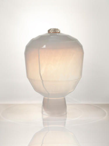 <p>Studio Furthermore's Lacuna lamp features a low-tech mouth-blown glass shade and LED light source.</p>