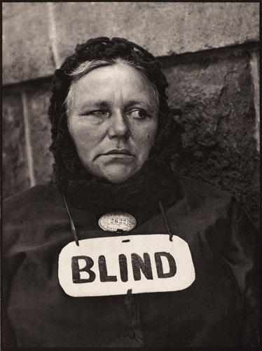 <p>Strand used a camera with a fake, misleading lens to get candid street photos. Paul Strand, American (1890–1976). <em>Blind woman, New York</em>, 1916.</p>