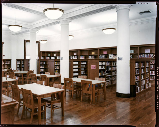 <p>The reading room of the Tremont public library in the Bronx</p>