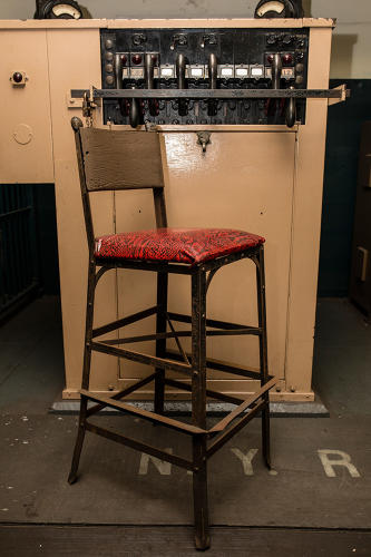 <p>A barstool at the New York Transit Museum</p>