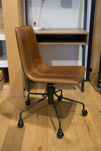 <p>A leather task chair at West Elm</p>