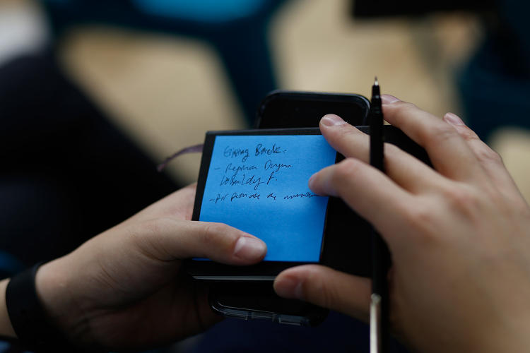 <p>Audience member takes notes during the Policy Genius/Fast Company Innovation Festival panel.</p>